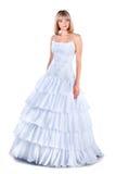 Tragendes Hochzeitskleid der schönen Braut getrennt Stockfotografie
