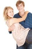 Tragendes Mädchen des Freundes in seinen Armen, Stockfotografie