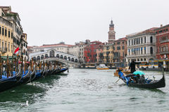 Traghetti boat in Grand Canal in Venice in rain. VENICE, ITALY - OCTOBER 14, 2016: traghetti boat in Grand Canal in Venice city in rainy autumn day. The Grand Royalty Free Stock Photos