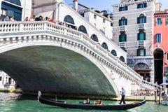 Traghetto boat with tourists near Rialto bridge Royalty Free Stock Image