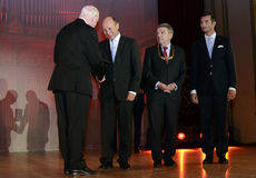 Traian Basescu. The President of European Olympic Committee offers a distinction to Romanian President Traian Basescu during the Romanian Olympic Committee Stock Images