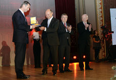 Traian Basescu. Romanian Olympic Committee President, Alin Petrache, offers a distinction to Romanian President Traian Basescu during the Romanian Olympic Stock Image