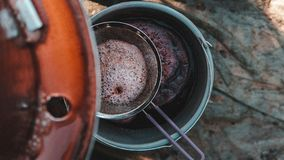 Traiditonal grape pressing and filtering in autumn. Traiditonal grape pressing and filtering in small villages . Old traditional way with bucket and pressing Royalty Free Stock Photos