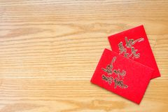 Traidtional Chinese red pockets on table with copy space Stock Photos