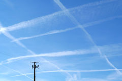 Trail of aircraft in the sky. Pattern of airplane trails of condensed air crisscrossing each Royalty Free Stock Photo