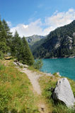 Trail by the alpine lake Royalty Free Stock Photo