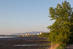 Trail through Anchorage. The Tony Knowles Coastal Trail winds toward downtown Anchorage, Alaska royalty free stock photos