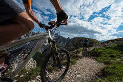 Trail biking. Bike tour on mountain trail Royalty Free Stock Photos