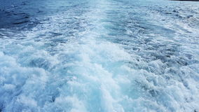 Trail from the boat. Water foam trace behind the large ship stock video