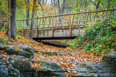 Trail Bridge. Crossing a dry stream with stone creek bed stock photo