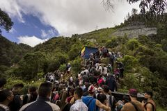 Crowds climbing there way up Monserrate. When the trail came to a halt, the hikers of Monserrate started to go off trail to find a faster way up royalty free stock images