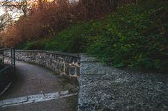 Trail by the city wall stock photography