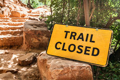 Trail Closed Sign along path in the woods. USA Royalty Free Stock Photography