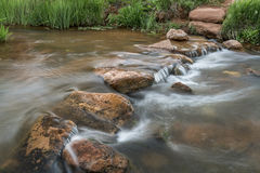 Trail crossing mountain creek. A trail crossing mountain creek with a row of step stones - Red Mountain Open Space, Colorado Stock Image