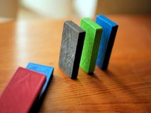 Colorful Wooden Dominoes in a Row Falling royalty free stock photo