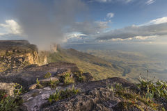 Trail down from the plateau Roraima passes under a falls - Venez Stock Image