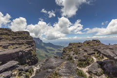 Trail down from the plateau Roraima passes under a falls - Venez Stock Photo