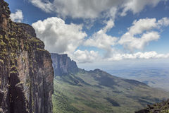 Trail down from the plateau Roraima passes under a falls - Venezuela, South America.  royalty free stock image