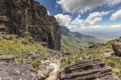Trail down from the plateau Roraima passes under a falls - Venezuela, South America.  stock photo