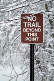 Trail End. A sign on a hikiong trail announcinc the dead end of a trail.  Photographed after a heavy snowfall Royalty Free Stock Images