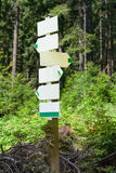 Trail forest direction sign crossroad post Stock Photography
