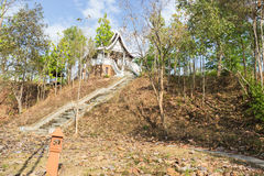 Trail in the forest to the stair to asian building Stock Photography