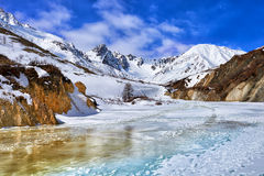 Trail on frozen river in mountains of Eastern Sayan Stock Photos