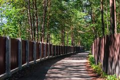 Trail in holiday village. The wide trail in the holiday village, leading along the fences Royalty Free Stock Photos
