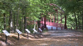 Trail leading across bridge (5 of 6). A view or scene of Parks and recreation stock footage