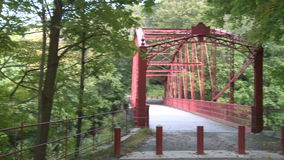 Trail leading across bridge (4 of 6). A view or scene of Parks and recreation stock footage