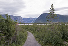 Trail leading to a fjord Stock Photo