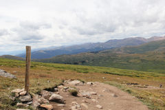 Trail marker leading to Colorado mountain peak Stock Images