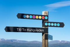 Trail marker sign showing the direction of the the Kungsleden hiking trail stock photos