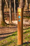 Trail marker with symbols. A trail marker in the woods indicates multiple options for hikers and equestrians Stock Photography