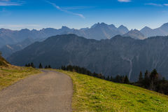 Trail and meadow in the mountains Royalty Free Stock Photos