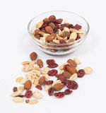 Trail mix. In a clear glass bowl, some spilled Stock Photos