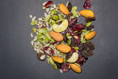 Trail mix on the black background. Royalty Free Stock Photography