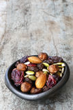 Trail Mix in Black Bowl. Delicious healthy fruit, nuts and seeds royalty free stock photos