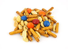 Trail mix with candy pieces. A small serving of trail mix with candy on a white background royalty free stock images