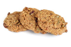 Trail mix cookies. Three oatmeal cookies with dried fruit, nuts and seeds on white background stock photos