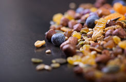 Trail mix. On a dark wood background stock photography