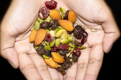 Trail mix on the hand. Stock Photos