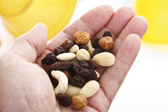 Trail mix in hand palm Royalty Free Stock Image