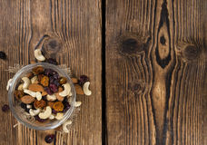 Trail Mix. Portion of mixed nuts and fruits (trail mix) on wooden background Stock Image