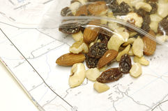 Trail Mix Travel Snack on Map. Close-up shot of trail mix snack in clear plastic bag on map stock images