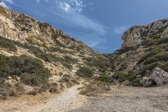 Matala , Red beach. Trail of the mountain on a nudist and hippie beach red beach near Matala, Crete, Greece , Europe Stock Photo