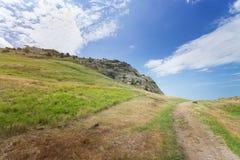 Trail near mountain peaks Stock Photo