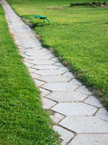 Trail in the park with green bench stock photos