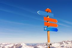 Trail post with majestic mountain peaks covered in snow. French alps royalty free stock images