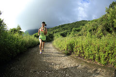 Trail runner athlete running on forest trail Stock Images